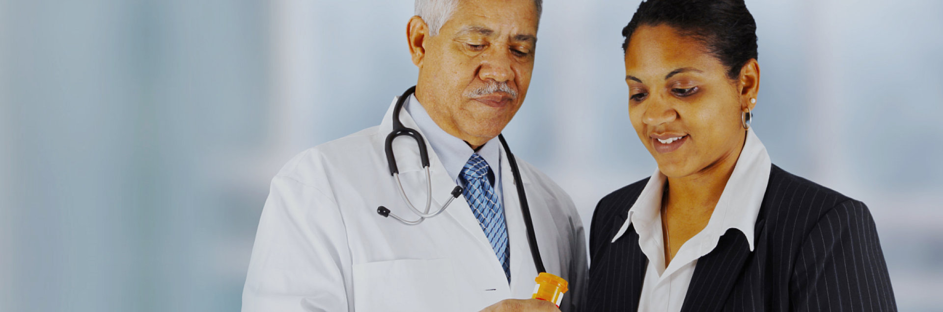 doctor and woman looking at medicine